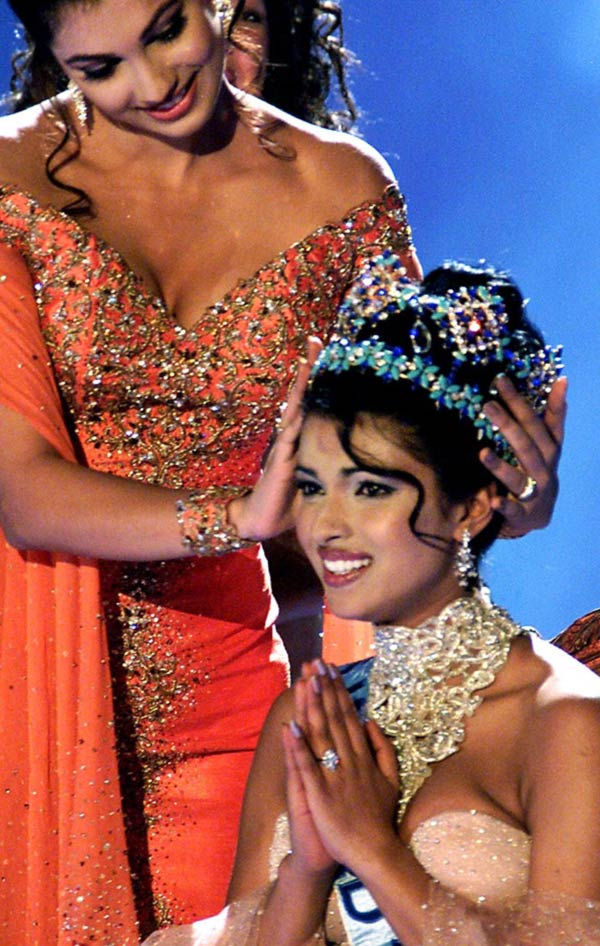 Miss India, Priyanka Chopra (R) is crowned by Miss World 1999, Yukta Mookhey after winning the Miss World contest at the Millennium Dome in London November 30, 2000. Ninety-five girls from various different countries around the world competed for the coveted title of Miss World, as the contest celebrates its 50th anniversary.