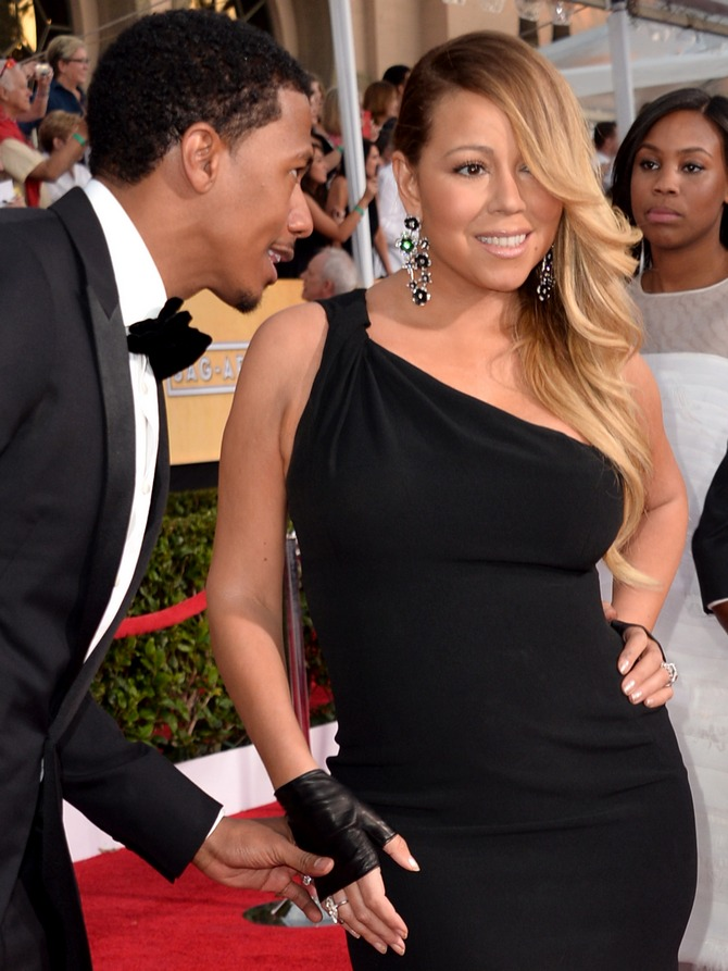 Honey, don't you remember Kim...? Nick Cannon seems to ask Mariah Carey :-)
