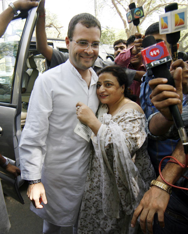 A well-wisher embraces Rahul Gandhi as he leaves after casting his vote at a polling station in New Delhi in this May 2009 picture.