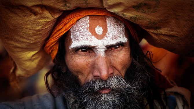 A nameless Hindu pilgrim makes his way around at the Kumbh mela.