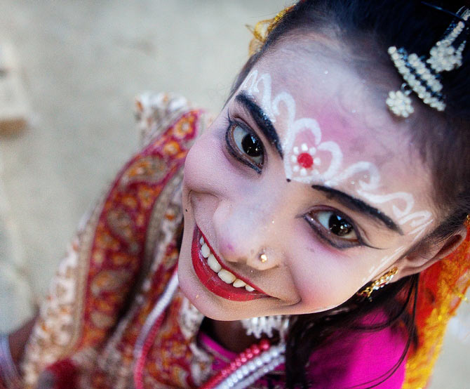 This image was commended at the 2014 Sony World Photography Awards (Smile section). The spontaneous emotion, the sweet smile of the girl participating in a local festival attracted me to shoot her photograph from a different angle.