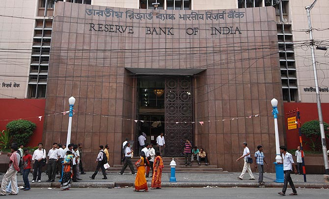 People walk in front of the Reserve Bank of India (RBI) building in Kolkata