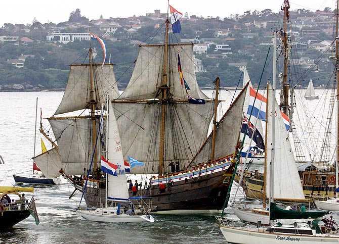 Spectator craft escort the Duyfken as she leaves Sydney harbour on her 18,000-nautical mile voyage to The Netherlands