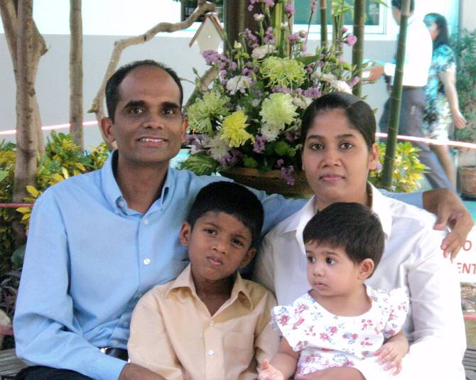 Joy Kuttappan and Gauri Swamy with their two children