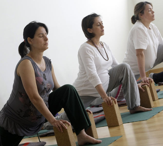 Pregnant women attend a yoga class in Madrid