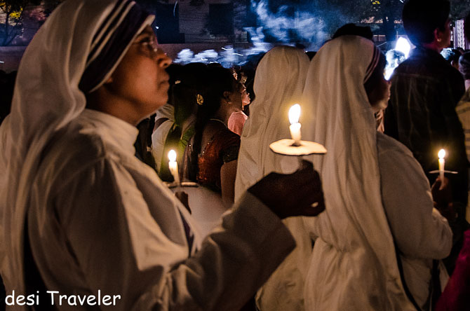 Nuns pray at the midnight mass.