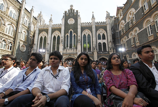 Students listen to U.S. President Barack Obama during a town hall meeting at St. Xavier's College in Mumbai November 7, 2010.