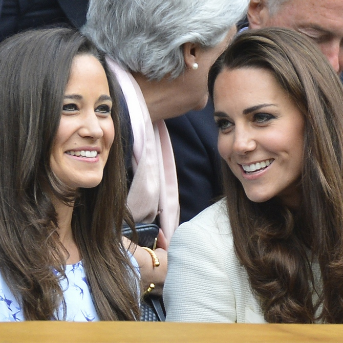 Pippa Middleton with her sister on Centre Court for the men's singles final tennis match between Roger Federer of Switzerland and Andy Murray of Britain at the Wimbledon Tennis Championships in London.