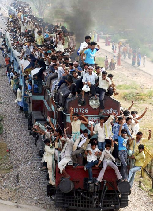 Hindu devotees travel on a crowded passenger train to take part in the 'Guru Purnima'.