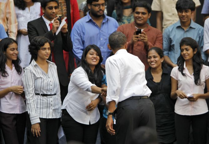 U.S. President Barack Obama greets students at a town hall meeting at St. Xavier's college in Mumbai.