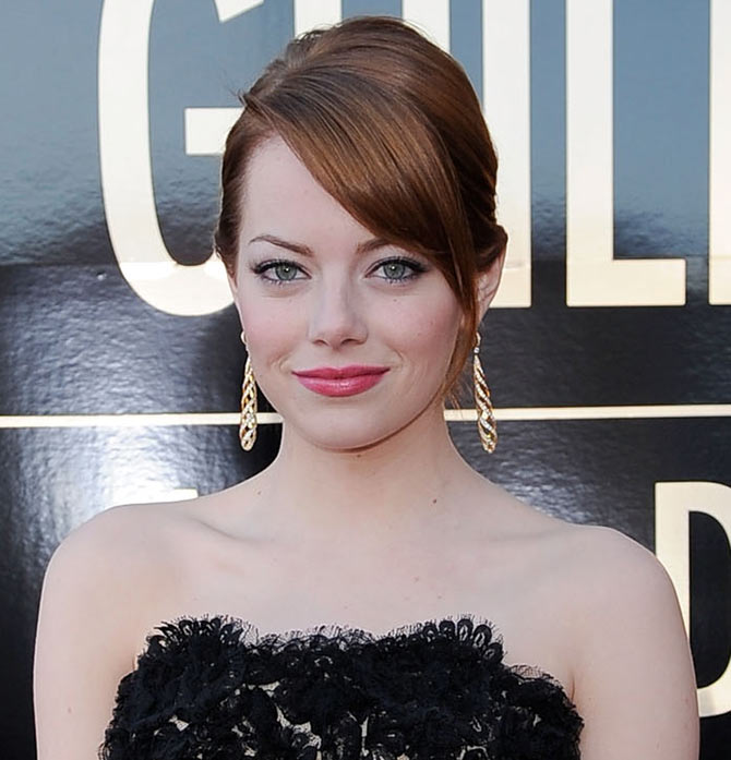 Actress Emma Stone arrives at the 18th Annual Screen Actors Guild Awards at The Shrine Auditorium on January 29, 2012 in Los Angeles, California.