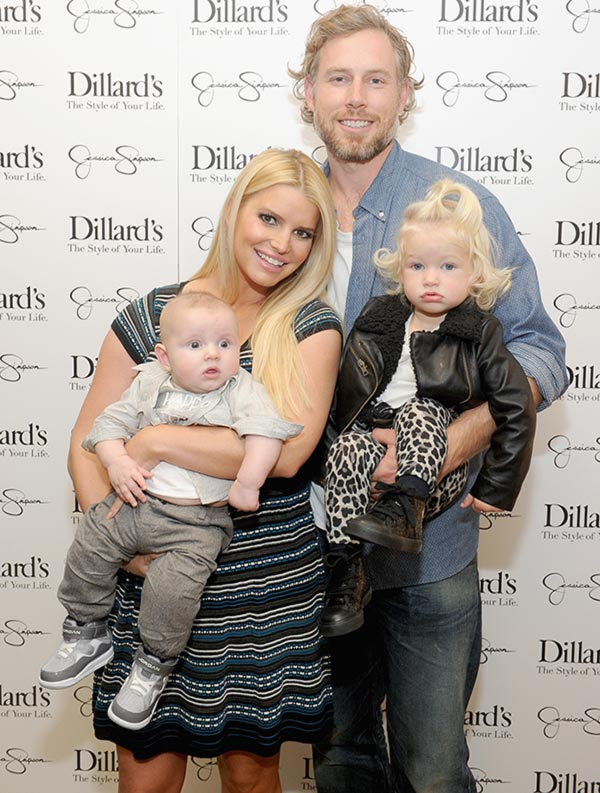 (L-R) Ace Johnson, Jessica Simpson, Eric Johnson and Maxwell Johnson attend a Jessica Simpson Collection event at Dillard's on November 23, 2013 in Dallas, Texas.