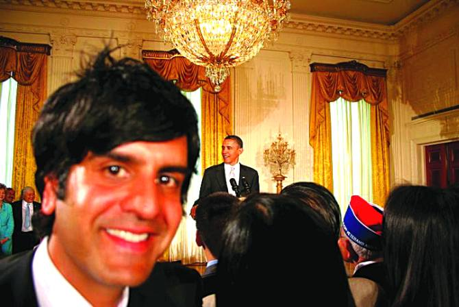 Siddhartha Khosla of Goldspot in the East Room at the White House at a Diwali celebration. In the background is US President Barack Obama