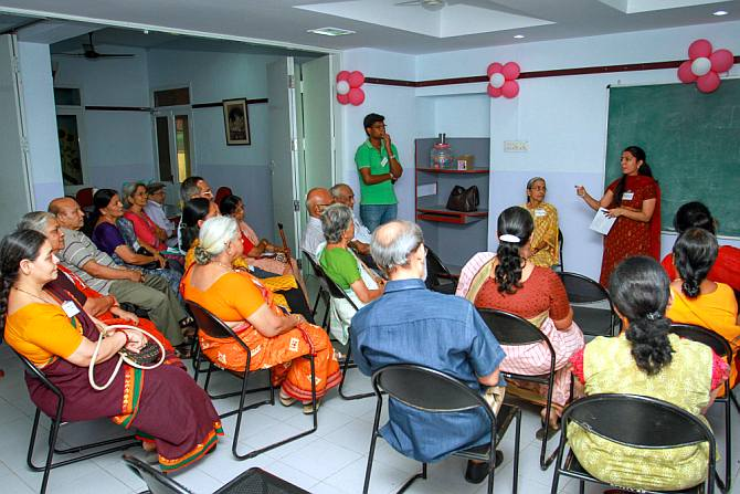 Rama Murali addressing a meeting of caregivers in Chennai