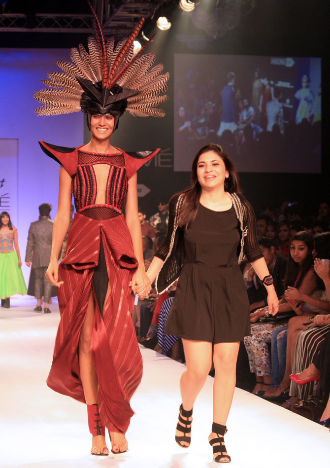 Neha Agarwal with a model showing the designer's creation.
