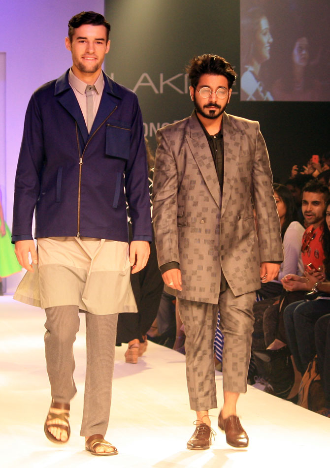 Anuj Bhutani with a model showing the designer's creation.