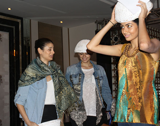 Models Michelle, Jasenka Bijelic and Nikhila Nandgopal backstage at LFW.