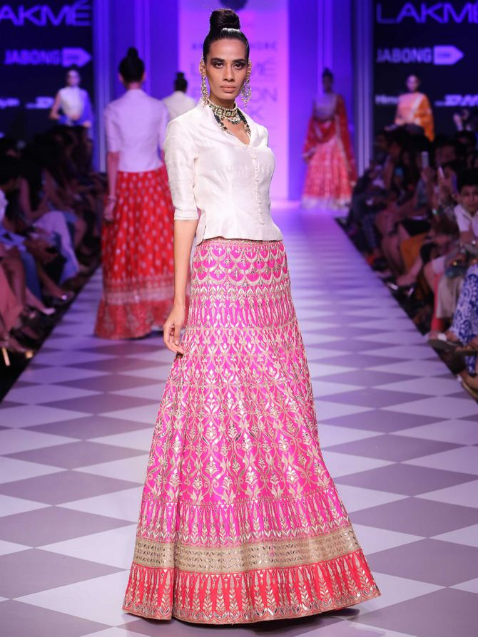 Sony Kaur models a pink lehenga by Anita Dongre.
