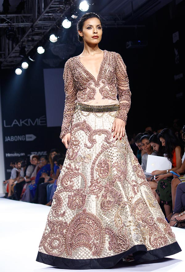 Model Deepti Gujral in Jade by Monica Shah and Karishma Swali.