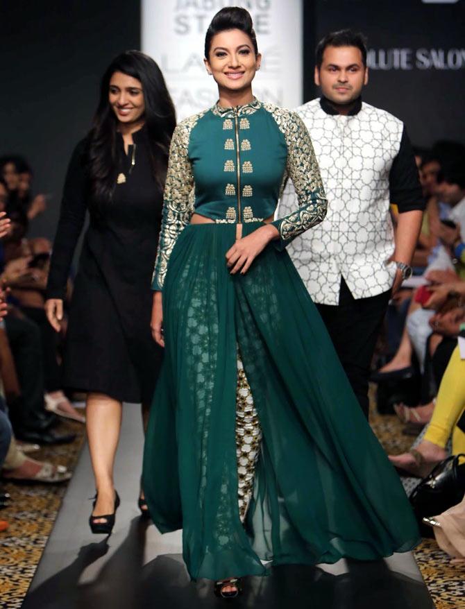 Gauhar Khan walks with designer duo Sonam and Paras Modi.