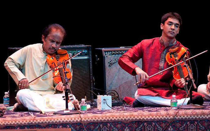 Ambi performing with father L Subramaniam