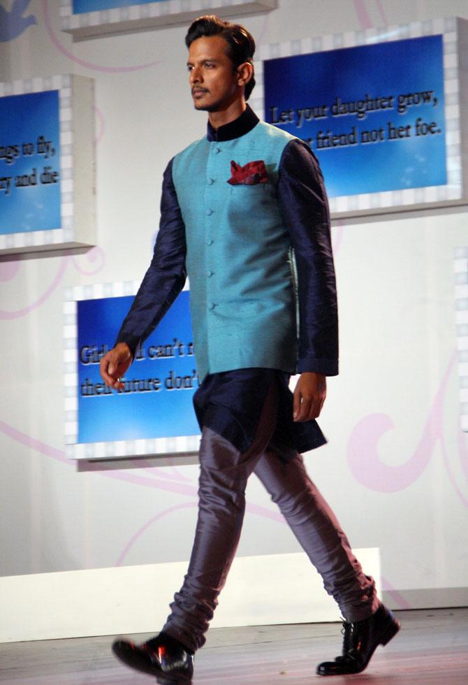 A model walks in a Manish Malhotra outfit