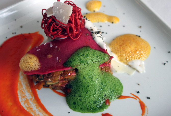 Beetroot and roasted vegetable lasagna with spicy pumpkin fritters, carrot and basil foam