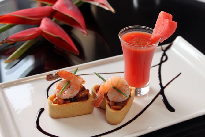 Duo of pickled water melon gazpacho with warm shrimp caponata tart, Cranberry and red pepper caulis
