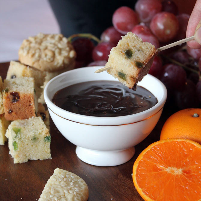 Chocolate fondue with fresh fruits, dense walnut cake and peanut cookies