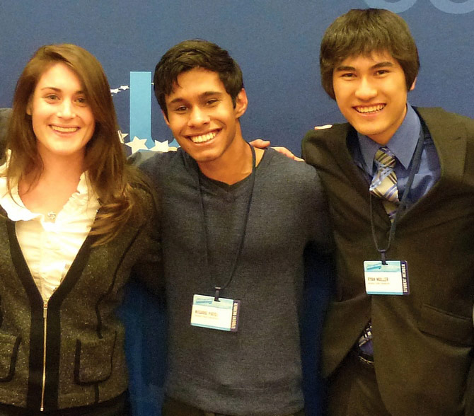 Nisarg Patel, center, with some of the HydroGene team members at the Clinton Global Initiative University.