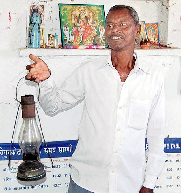 Dalu Mahato, a temporary ticket seller enters the station only after a daily puja
