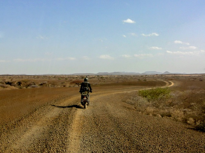 Riding the deserts along Lake Turkana, Kenya.