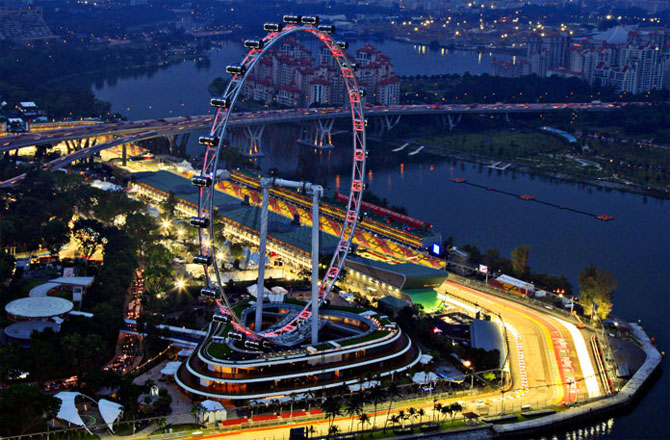 A part of the illuminated Marina Bay street circuit of the Singapore Formula One Grand Prix around the Singapore Flyer.