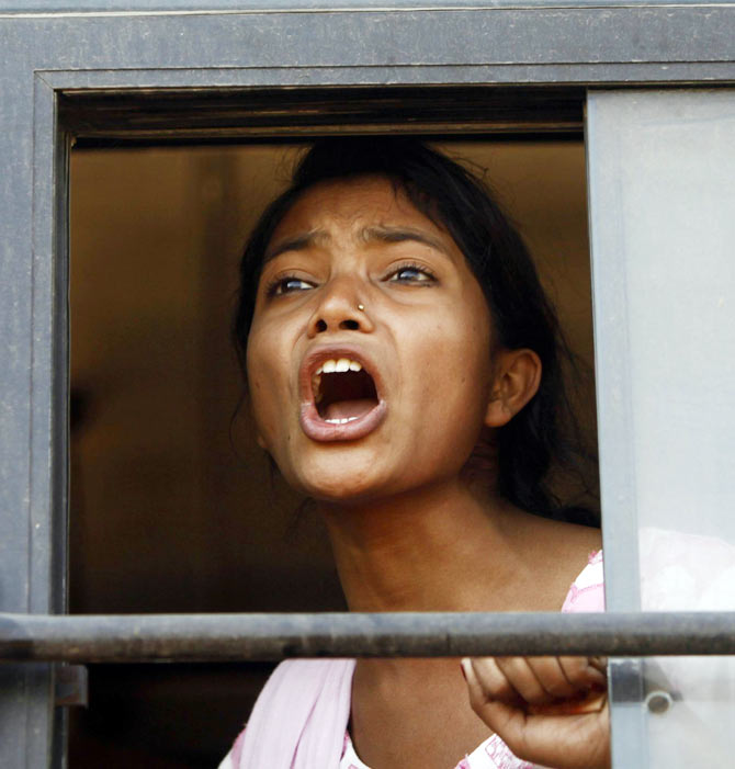 A demonstrator shouts slogans from inside a bus after she was detained by police near the Rashtrapati Bhavan during a protest rally organised by various women's organisations in New Delhi December 21, 2012.