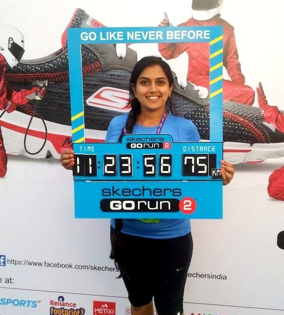 Deepa Katrodia at the end of her Bangalore Ultra Marathon holding up her timing.