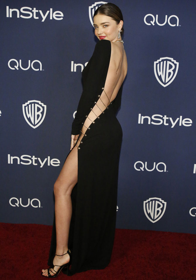 Model Miranda Kerr poses at the 15th annual Warner Bros. and InStyle after party, after the 71st annual Golden Globe Awards in Beverly Hills, California January 12, 2014.