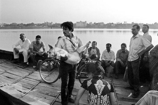 Sandip Karan carries a patient home for treatment