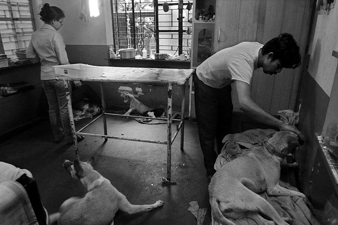 Sandip Karan examines a patient in his home-hospital