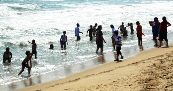 Frolickers at the Marina Beach in Chennai.