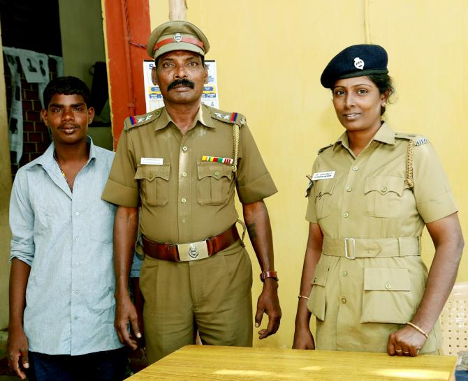 Venkatesh, left, with Sub-Inspector Panneerselvam of the Anna Square police station, centre.