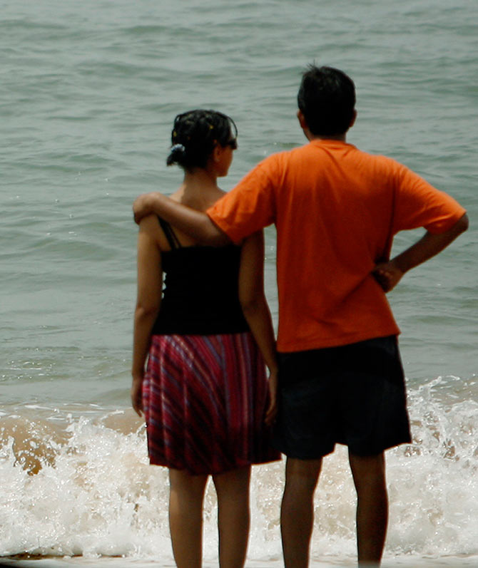 Tourists at Anjuna beach in the western Indian state of Goa