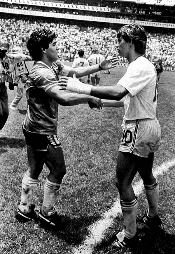 Argentine World Cup star Diego Maradona (L) is greeted by England's Gary Lineker (R) on the pitch following their World Cup quarter final in Mexico, June 22, 1986. Maradona scored both goals in Argentina's 2-1 victory.