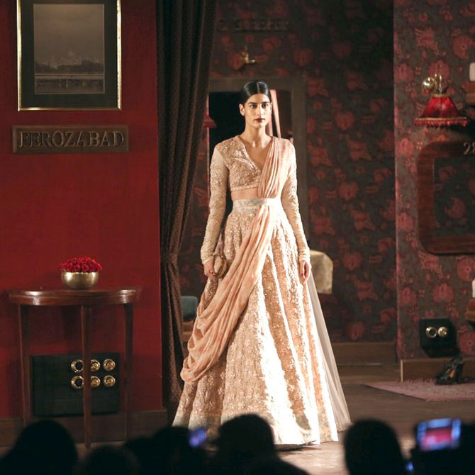 A model presents a design by Sabyasachi Mukherjee at India Couture Week.