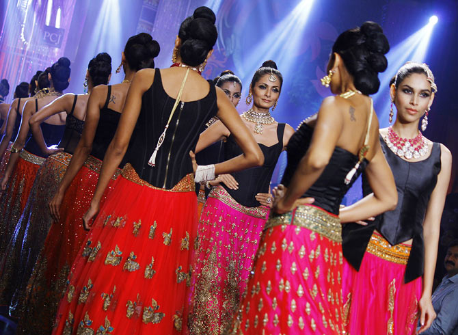 Sonal Rawat walks the runway at the India International Jewellery Week.