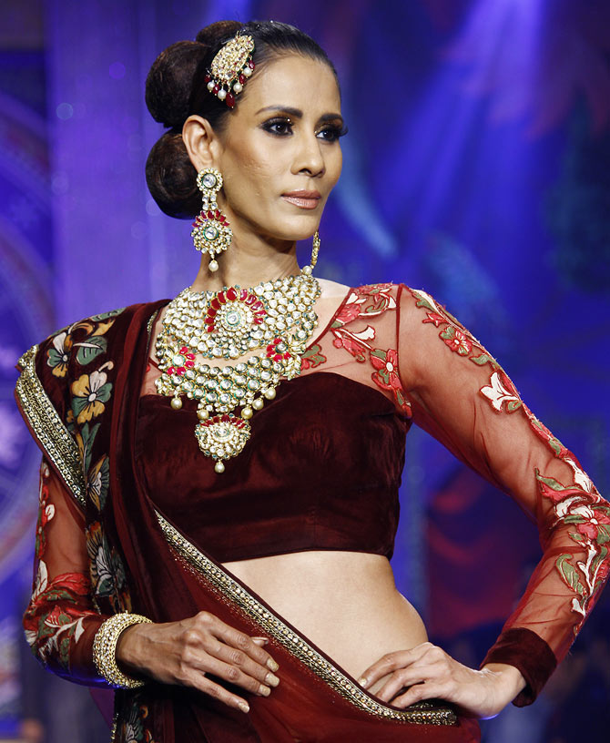 Kavita Kharayat walks the runway at the India International Jewellery Week.