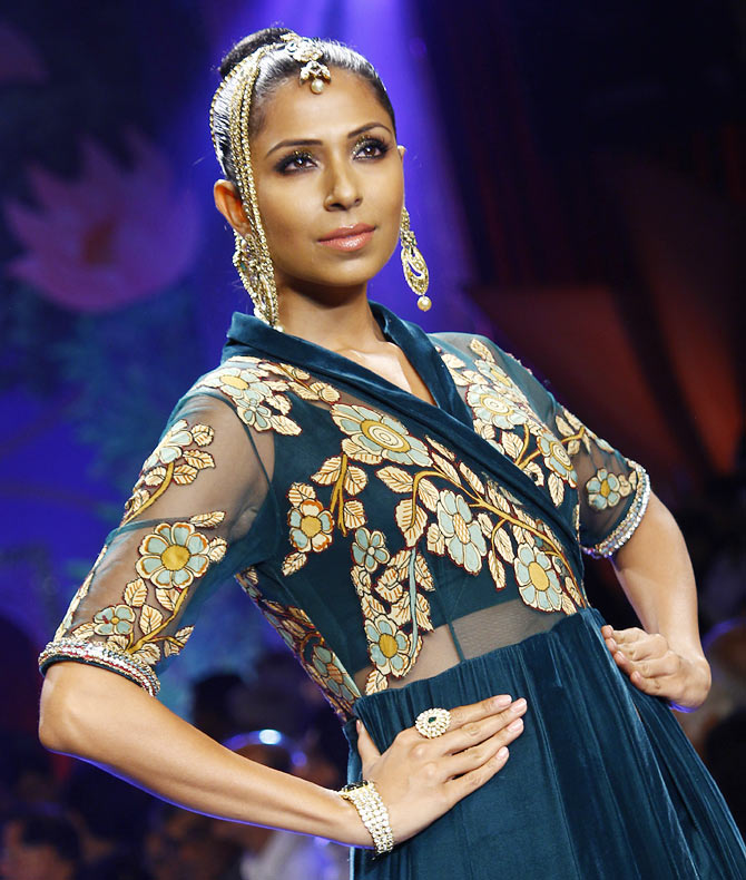 Candice Pinto walks the runway at the India International Jewellery Week.