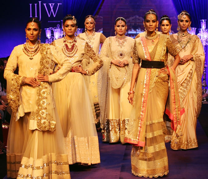 Models walk the runway at India International Jewellery Week