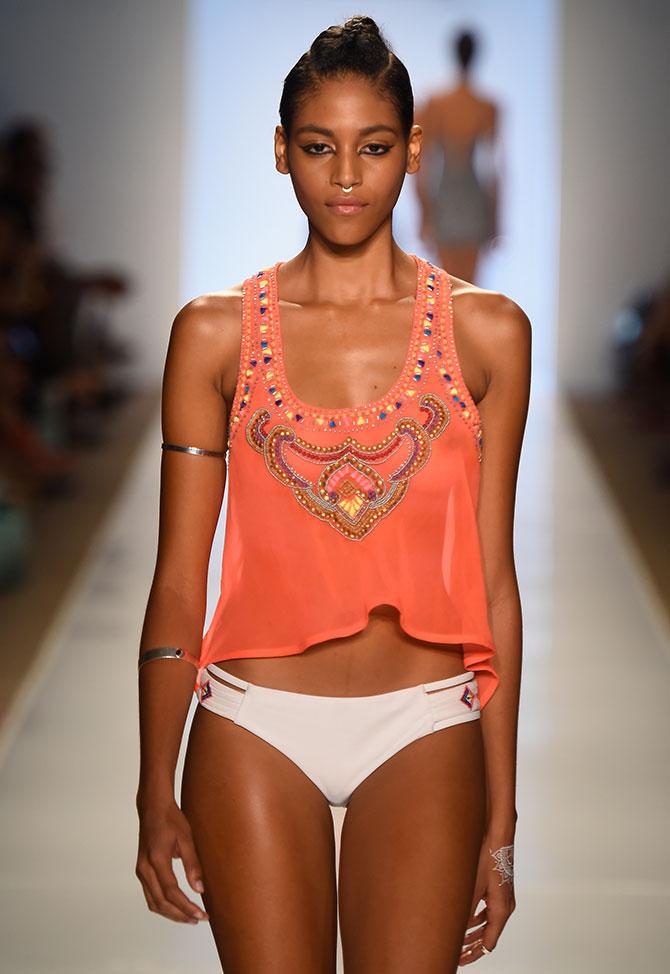 A model walks the runway for Pooja Kharbanda's new beachwear collection at Mercedes-Benz Swim Fashion Week.