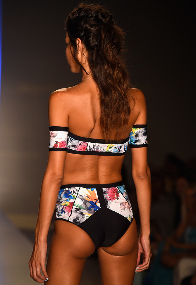 A model walks the runway at the Mercedes Benz Swim Fashion Week.