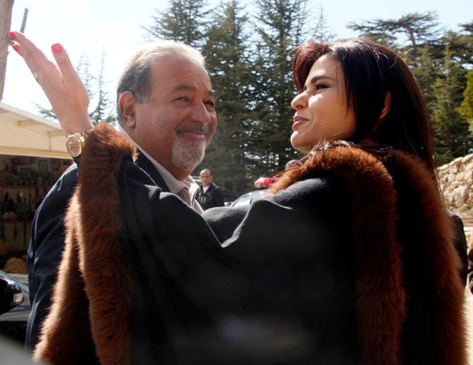 Lebanese MP Strida Geagea welcomes Mexican tycoon Carlos Slim, who is of Lebanese descent, as they tour Bcharreh's cedars forest, northern Lebanon March 17, 2010.